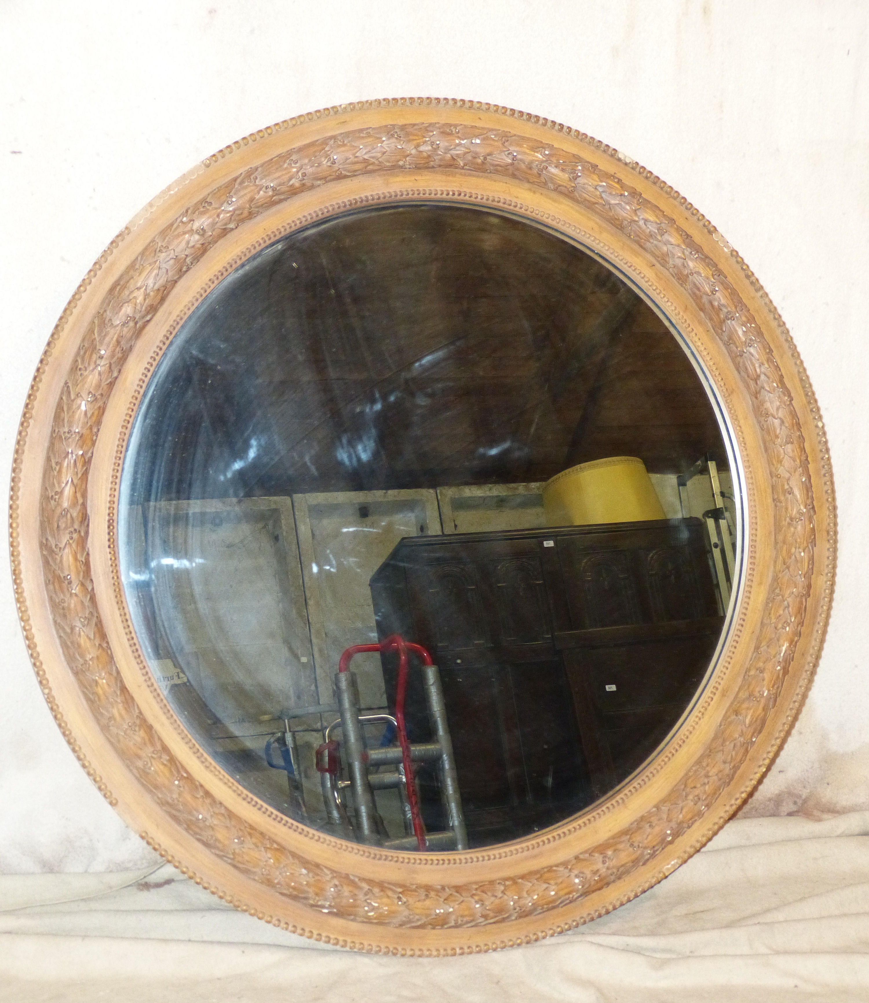 A Large Round Hanging Wall Mirror with raised berry and leaf decoration