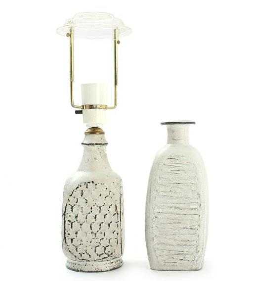 An earthenware vase and table lamp decorated with black/white double glaze