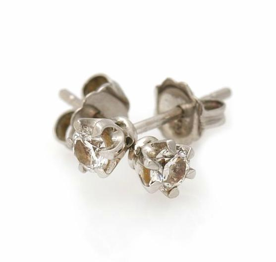 A pair of diamond ear studs each set with a brilliant-cut diamond, totalling app. 0.35 ct., mounted in platinum