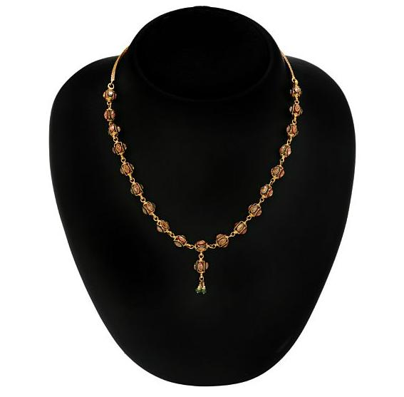 An Indian necklace with pendant set with fancy-cut cubic zirconia, red and green enamel