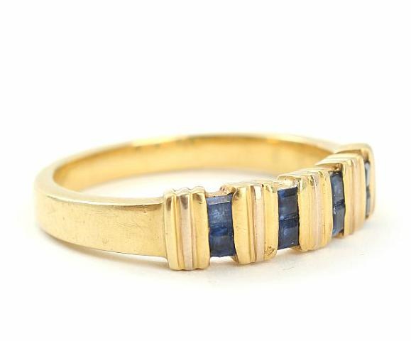 Egyptian sapphire ring set with numerous faceted sapphires mounted in 18k gold
