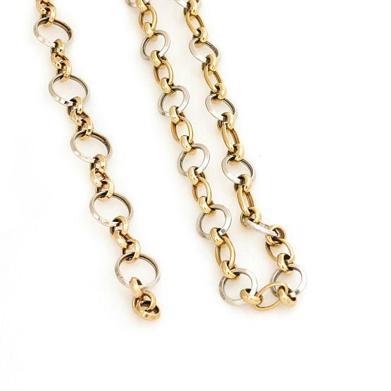 A jewellery collection of 14k bi-colour gold comprising a necklace and a bracelet
