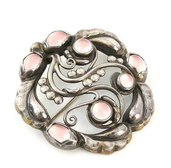 Rose quartz brooch set with cabochon-cut rose quartz mounted in sterling silver