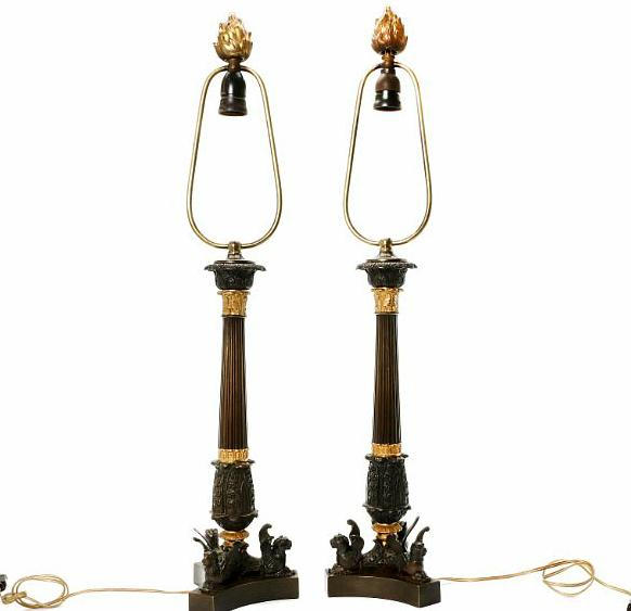 A pair of circa 1900 Charles X style patinated and gilt bronze lamps