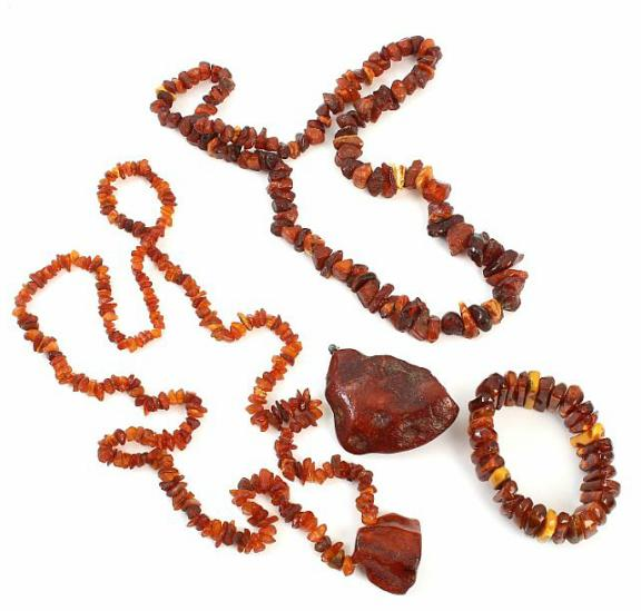 A selection of amber jewellery comprising two necklaces, a bracelet