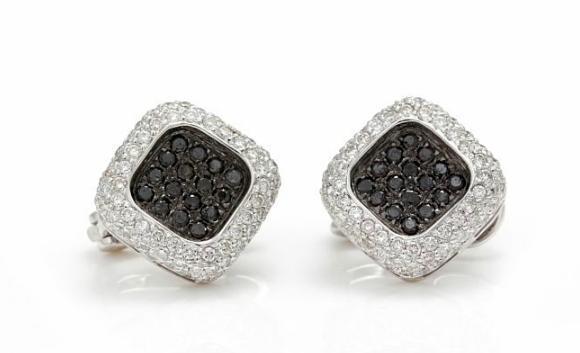 A pair of diamond ear pendants set with numerous brilliant-cut black