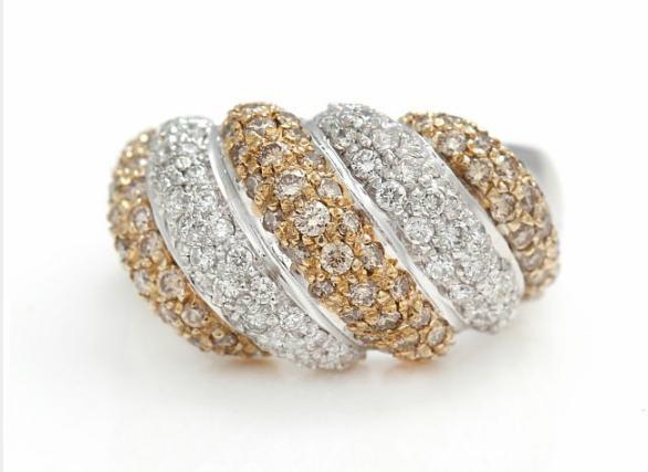 A diamond ring set with numerous white
