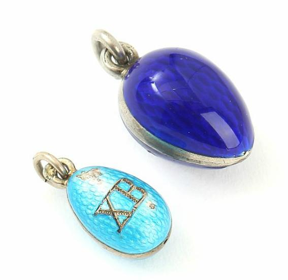 Two Russian silver pendants in the shape of Easter eggs set