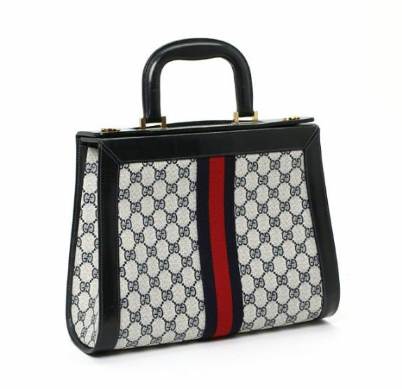 A handbag of monogram canvas with navy leather trimmings