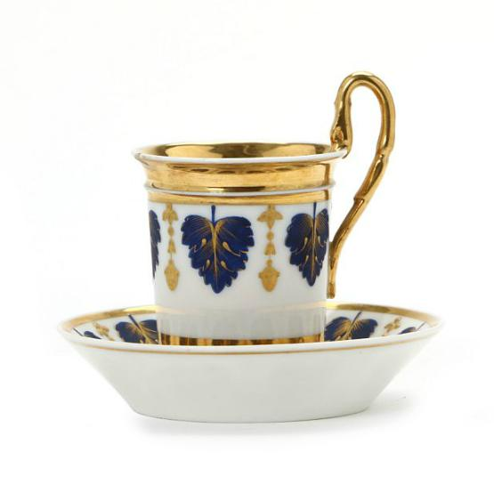 French Empire cup and saucer decorated in gold and blue leaves