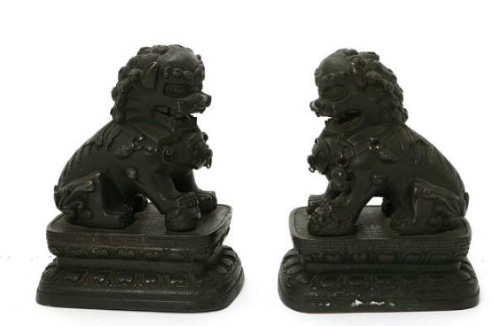 A pair of Chinese Qing 19th c. patinated bronze Fo dogs