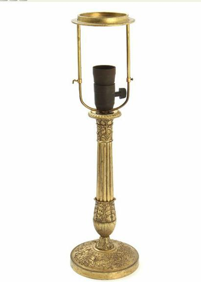 A French 19th century gilded bronze table lamp, cast with foliage, arrows and torches