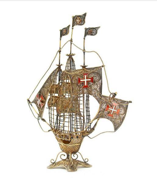A gilt sterling silver filigree ship embellished with enamel