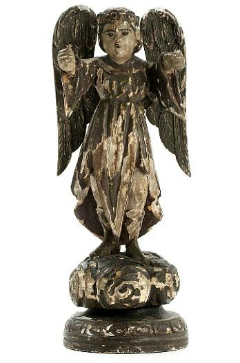 An 18th century wooden Philippine angel standing on a carved base