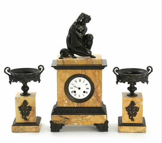 A 19th century French patinated bronze and marble clock garniture