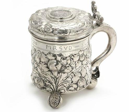 A silver tankard, Baroque style