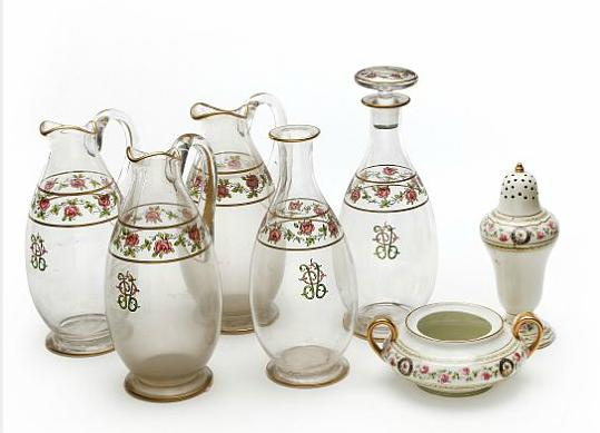 Two decanters, three jugs of glass with painted rose garland including four with monogram