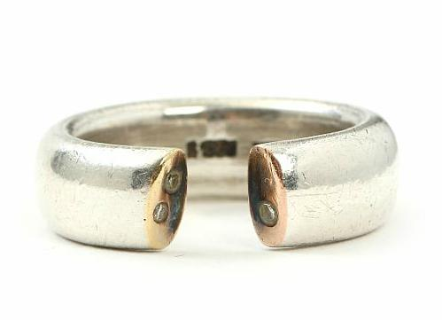 A diamond ring set with brilliant-cut diamonds mounted in sterling silver and gold. Weight app. 11 gr. Size 55
