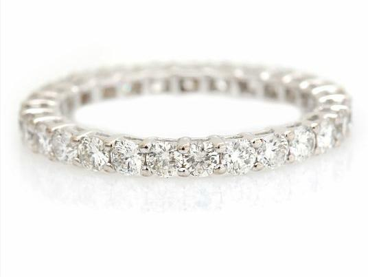 A diamond eternity ring set with numerous brilliant-cut diamonds weighing a total of app. 1.40 ct., mounted in 18k white gold. S