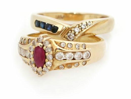 Two rings respectively set with sapphires, a ruby, diamonds and transparent stones, mounted in 14k gold. Size 53 and 54