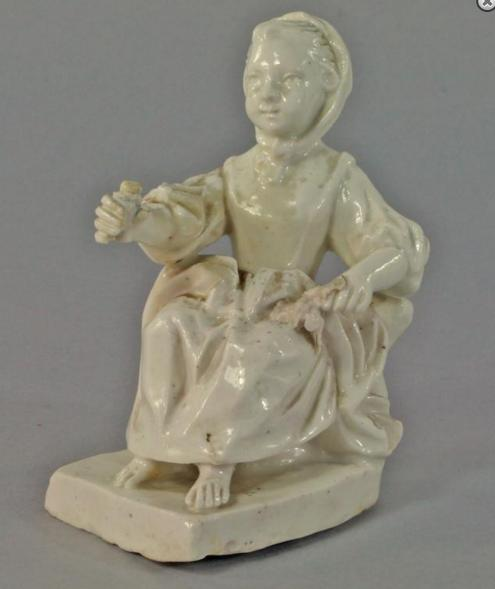 A Continental porcelain figure of a young girl