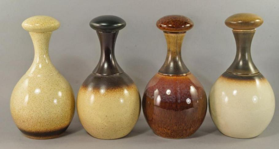 A collection of Rye Pottery to comprise four bottle vases with bulbous stoppers