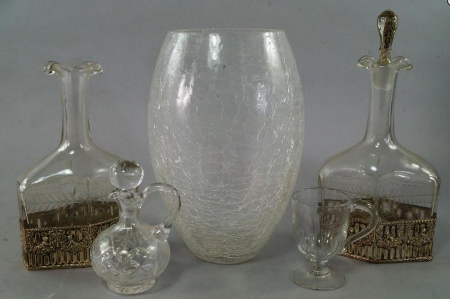 A pair of glass oil jars