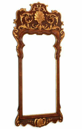 A rococo style walnut and giltwood mirror