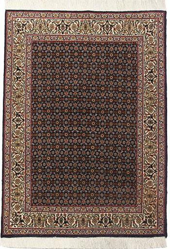 Täbriz tæppe, all over design med blomster og bladværk på blå bund. Persien. 20. årh.s slutning