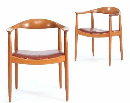 """""""The Chair"""". A pair of mahogany armchairs. Seat upholstered with red leather"""