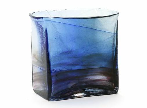 A four-sided vase of transparent and light blue glass with formations of violet, brown and dark blue glass