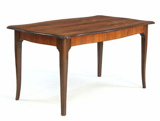 A rosewood dining table with profiled edges and cabriole legs