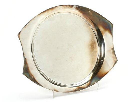 A sterling silver serving tray with concave sides