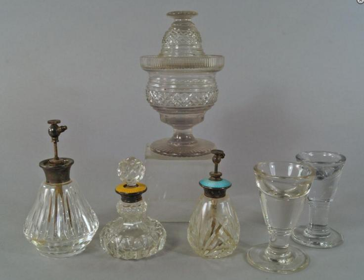 A Regency cut glass vase and cover, of bellied design, cut with cross hatching