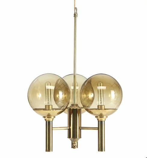 Three armed chandelier of brass with orb shaped screens of smoke coloured glass