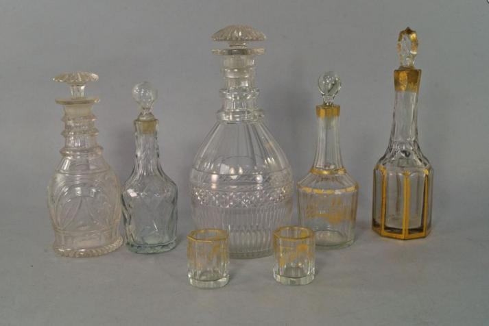 A glass decanter and stopper, possibly Irish, cut with a multi-faceted body