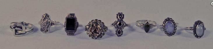 A collection of eight silver rings, most marcasite set