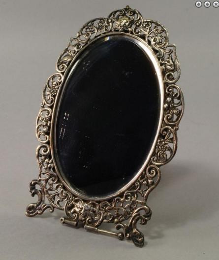 A rare Victorian silver convertible hand / strut mirror