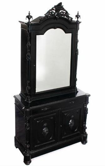 A black lacquered mahogany Baroque style cupboard, front with three doors, top with mirror