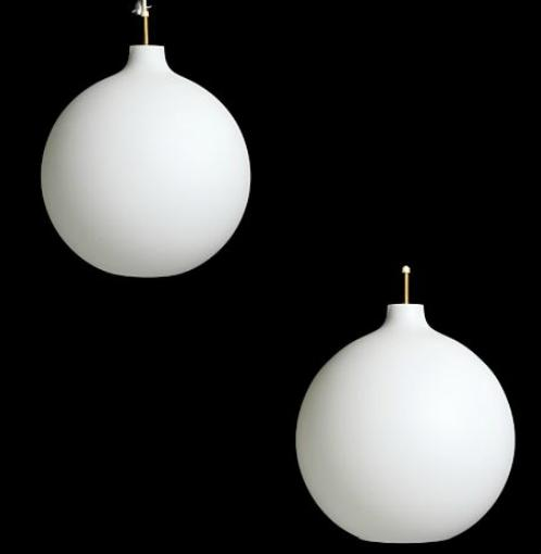 """""""Satelit"""". A pair of frosted opal glass pendants"""