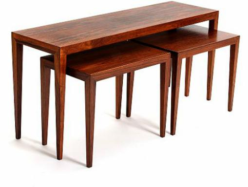 Three Brazilian rosewood nesting tables with tapering legs