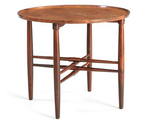 Circular coffee table of rosewood with cross bars and top with raised edge