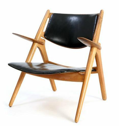 """""""Savbukkestolen"""". Easy chair with oak frame. Seat and back upholstered with black leather"""