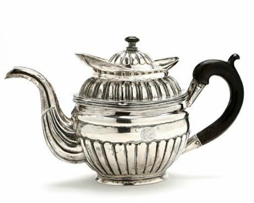 A 19th century Biedermeier silver teapot with handle of ebony. Weight 663 gr