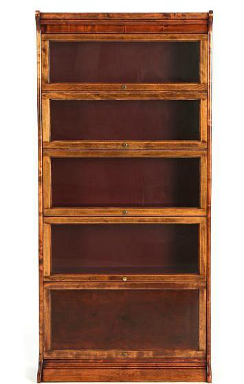A mahogany and birchwood display cabinet