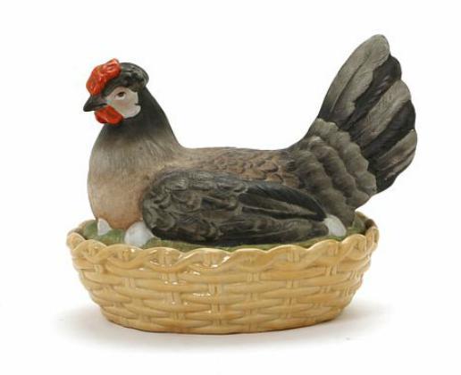 A 19th century porcelain lidded bowl shaped as a hen on nest marked Schierholtz Plaue