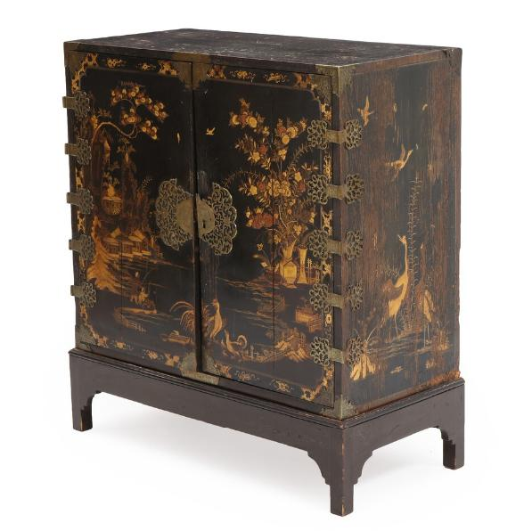 An English blacklacquered wood cabinet in the Chinese style, decorated in gold