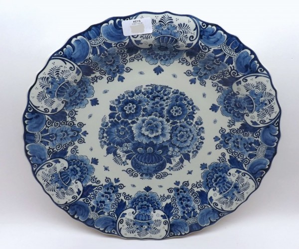 """20th century Delft plate decorated in blue and white with floral sprays marked """"ram, made in Holland"""" to reverse, 15 ½"""" diameter"""