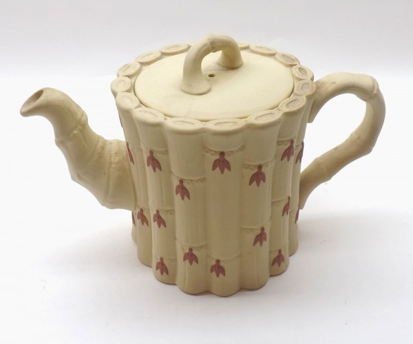 Wedgwood Queens ware cane ware teapot and cover, moulded pâte-sur-pâte and decorated in red with bellflowers