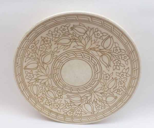 """Charlotte Rhead Bursley ware charger, decorated with tube lined floral design, marked to reverse TL14, 12"""" diameter"""